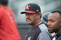 Kannapolis Intimidators pitching coach Jose Bautista (38) watches the action from the dugout during the game against the Rome Braves at Kannapolis Intimidators Stadium on April 7, 2019 in Kannapolis, North Carolina. The Intimidators defeated the Braves 2-1. (Brian Westerholt/Four Seam Images)