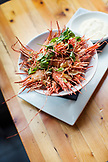 CANADA, Vancouver, British Columbia, a bowl of fried shrimp heads are served at a local bistro, Edible Canada, located on Granville Island