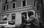 ROME, ITALY - MAY: A man on a moped shows off his middle finger while passing by in May of 2001 in Rome, Italy (Photo By Donald Miralle)