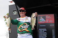 NWA Democrat-Gazette/FLIP PUTTHOFF <br /> Tournament leader Scott Canterbury of Springville, Ala., shows two bass from his Saturday April 16, 2016 catch of 14 pounds, 6 ounces that moved him from second place on Friday to first on Saturday.