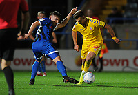 Bolton Wanderers' Dennis Politic is tackled by Rochdale's Aaron Morley<br /> <br /> Photographer Kevin Barnes/CameraSport<br /> <br /> EFL Leasing.com Trophy - Northern Section - Group F - Rochdale v Bolton Wanderers - Tuesday 1st October 2019  - University of Bolton Stadium - Bolton<br />  <br /> World Copyright © 2018 CameraSport. All rights reserved. 43 Linden Ave. Countesthorpe. Leicester. England. LE8 5PG - Tel: +44 (0) 116 277 4147 - admin@camerasport.com - www.camerasport.com