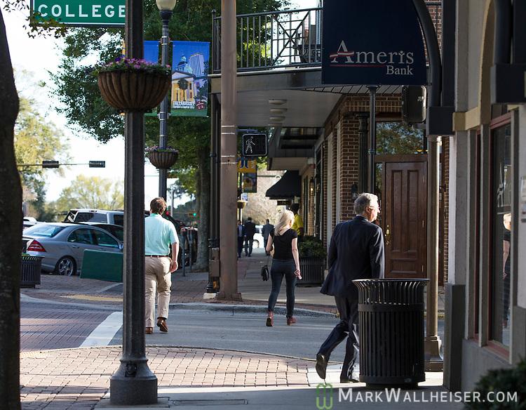 People walk in downtown Tallahassee, Florida