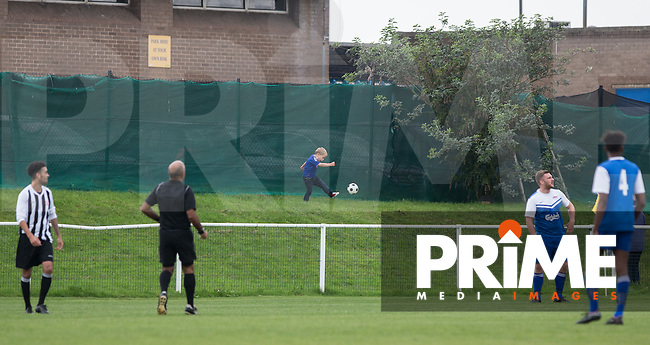 A young supporters kicks a ball around during the match during the Molten Spartan South Midlands Premier match between Oxhey Jets and Colney Heath on Non League Day at Altham Way, South Oxhey, England on 10 October 2015. Photo by Andy Rowland.