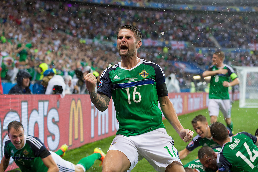 GOAL CELEBRATION - Northern Ireland's Oliver Norwood celebrates his side's opening goal <br /> <br /> Photographer Craig Mercer/CameraSport<br /> <br /> International Football - 2016 UEFA European Championship - Group C, Ukraine v Northern Ireland - Thursday, 16th June 2016 - Stade de Lyon, Lyon, France<br /> <br /> World Copyright &copy; 2016 CameraSport. All rights reserved. 43 Linden Ave. Countesthorpe. Leicester. England. LE8 5PG - Tel: +44 (0) 116 277 4147 - admin@camerasport.com - www.camerasport.com