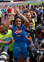 Napoli's Edinson Cavani  celebrates victory and the qualification of the SSC Napoli team in the UEFA Champions League during the Italian Serie A football match between SSC Napoli and Siena at the San Paolo stadium in Naples.NAPOLI CACIO FESTA QUALIFICAZIONE  CHAMPIONS