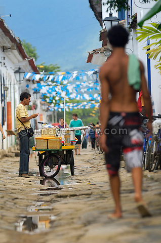 Local brazilian man selling goods of his mobile shop in the historic centre; Paraty, Brazil. The beautiful colonial town of Paraty has been a UNESCO World Heritage Site since 1958. --- No signed releases available.
