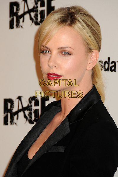 "Charlize Theron.""Rage"" Video Game Launch Party held in Chinatown's Historical Central Plaza, Los Angeles, California, .30 September 2011..portrait headshot red lipstick make-up beauty black .CAP/ADM/BP.©Byron Purvis/AdMedia/Capital Pictures."
