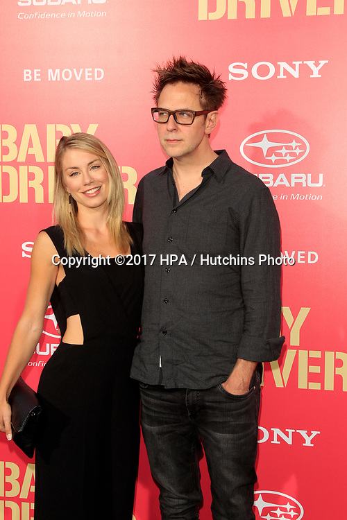 """LOS ANGELES - JUN 14:  Jennifer Holland, James Gunn at the """"Baby Driver"""" Premiere at the The Theater at Ace Hotel on June 14, 2017 in Los Angeles, CA"""