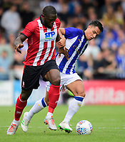 Lincoln City's John Akinde vies for possession with Sheffield Wednesday's Joey Pelupessy<br /> <br /> Photographer Chris Vaughan/CameraSport<br /> <br /> Football Pre-Season Friendly - Lincoln City v Sheffield Wednesday - Saturday July 13th 2019 - Sincil Bank - Lincoln<br /> <br /> World Copyright © 2019 CameraSport. All rights reserved. 43 Linden Ave. Countesthorpe. Leicester. England. LE8 5PG - Tel: +44 (0) 116 277 4147 - admin@camerasport.com - www.camerasport.com