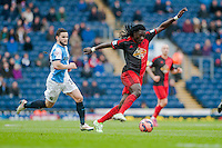 BLACKBURN, ENGLAND - JANUARY 24:   Bafetibis Gomis of Swansea City moves the ball forwards away from  Craig Conway of Blackburn Rovers during the FA Cup Fourth Round match between Blackburn Rovers and Swansea City at Ewood park on January 24, 2015 in Blackburn, England.  (Photo by Athena Pictures/Getty Images)