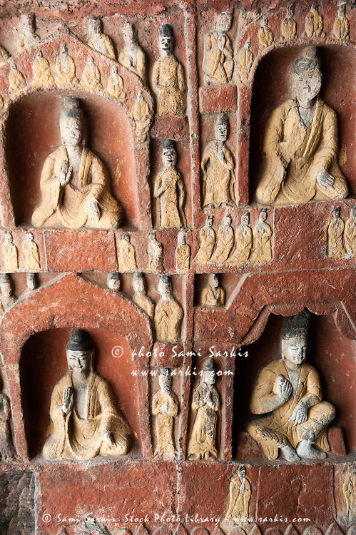 Carvings depicting Buddha on a wall inside the ancient Yungang Grottoes, Datong, Shanxi, China.