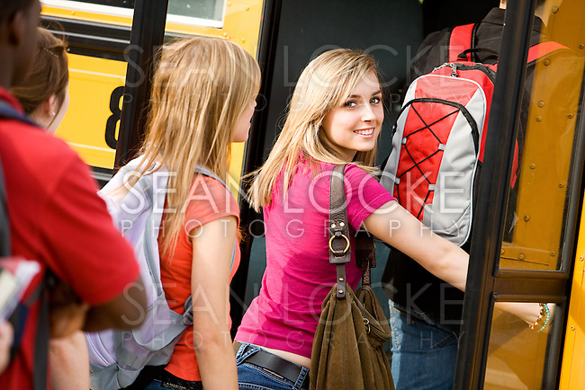 Series with multi-ethnic group of teenage students boarding and on a school bus.  Students boarding the bus.