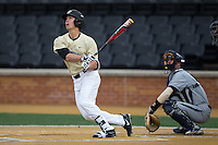Stuart Fairchild (4) of the Wake Forest Demon Deacons watches the flight of his solo home run against the UNCG Spartans at David F. Couch Ballpark on February 21, 2017 in  Winston-Salem, North Carolina.  The Demon Deacons defeated the Spartans 15-8.  (Brian Westerholt/Four Seam Images)