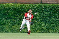 Outfielder Byron Buxton #11 catches a fly ball during the Under Armour All-American Game at Wrigley Field on August 13, 2011 in Chicago, Illinois.  (Mike Janes/Four Seam Images)