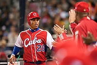 16 March 2009: #26 Leonys Martin of Cuba celebrates with teammates as he scores during the 2009 World Baseball Classic Pool 1 game 3 at Petco Park in San Diego, California, USA. Cuba wins 7-4 over Mexico.