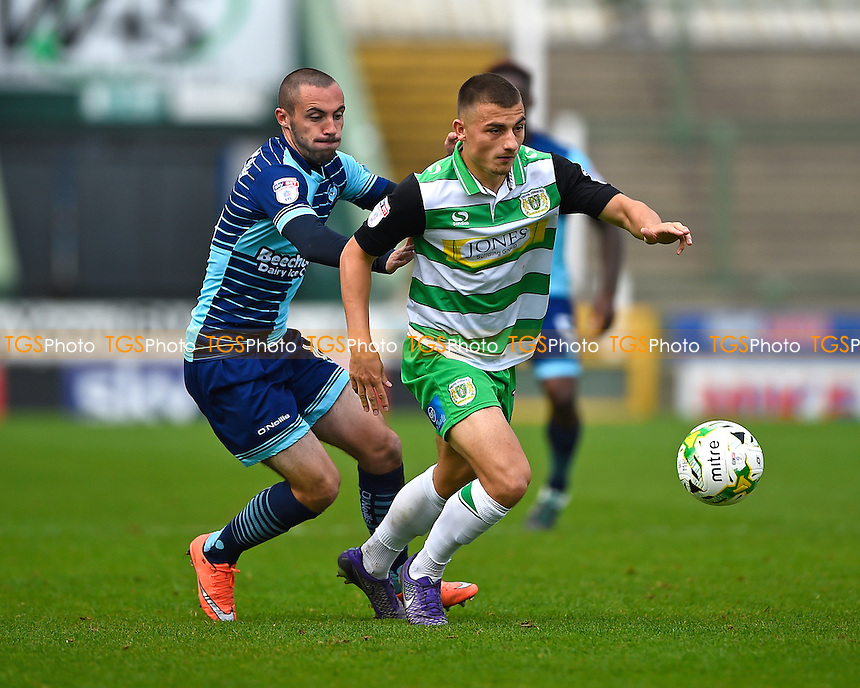 Otis Khan of Yeovil Town right is shadowed by Michael Harriman of Wycombe Wanderers during Yeovil Town vs Wycombe Wanderers, Sky Bet EFL League 2 Football at Huish Park on 8th October 2016