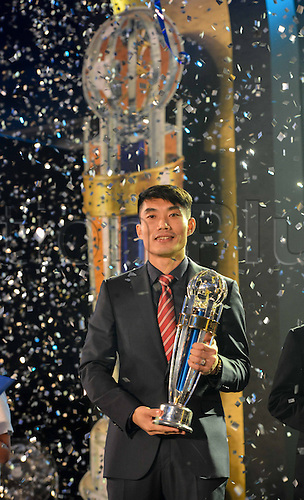 26.11.2013  Kuala Lumpur.  Zheng Zhi of China poses with his trophy at the AFC Player of the Year ceremony in Kuala Lumpur, Malaysia, on Nov. 26, 2013.