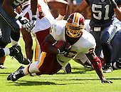 Landover, MD - October 2, 2005 --  visit the Washington Redskins running back Clinton Portis (26) tries to keep from going down in game action against the Seattle Seahawks at FedEx Field in Landover, MD on October 2, 2005.  The Redskins won the game 20 - 17..Credit: Ron Sachs / CNP