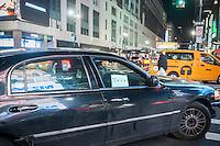 An Uber livery travels through Midtown Manhattan in New York on Tueday, January 12, 2016.  (© Richard B. Levine)