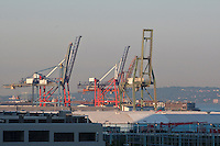 Cranes are seen in a port in the New York City borough of Brooklyn, NY, Monday August 1, 2011.