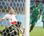 19 August 2008: Ambruse Vanzekin (NGA) (1) makes a point-blank save against Anthony Vanden Borre (BEL) (16).  The men's Olympic soccer team of Nigeria defeated the men's Olympic soccer team of Belgium 4-1 at Shanghai Stadium in Shanghai, China in a Semifinal match in the Men's Olympic Football competition.