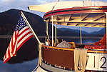 Alaska, Southeast Alaska, Passenger vessel, M/V Catalyst cruising Stephens Passage, These small ship cruises are by Pacific Catalyst II Inc. Detail of varnished stern, American flag,