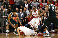 Ohio State Buckeyes guard Aaron Craft (4) dives on a loose ball in the second half of the NCAA men's basketball game between the Ohio State Buckeyes and the Michigan State Spartans at Value City Arena in Columbus, Ohio, Sunday afternoon, March 9, 2014. The Ohio State Buckeyes defeated the Michigan State Spartans 69 - 67. (The Columbus Dispatch / Eamon Queeney)