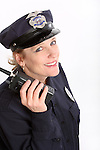 A woman security officer listening to a radio