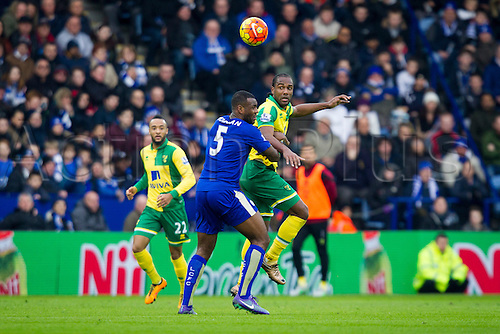 27.02.2016. King Power Stadium, Leicester, England. Barclays Premier League. Leicester City versus Norwich City. Cameron Jerome of Norwich City heads the ball on under pressure from Wes Morgan of Leicester City.