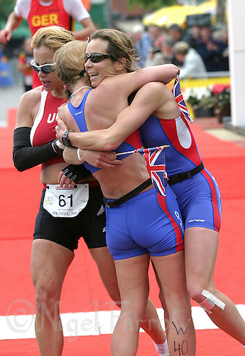 31 MAY 2004 - GEEL, BELGIUM - Juliet Vickery  (right) celebrates medalling at the 2004 World Duathlon Championships with Jeannie Fry. (PHOTO (C) NIGEL FARROW)