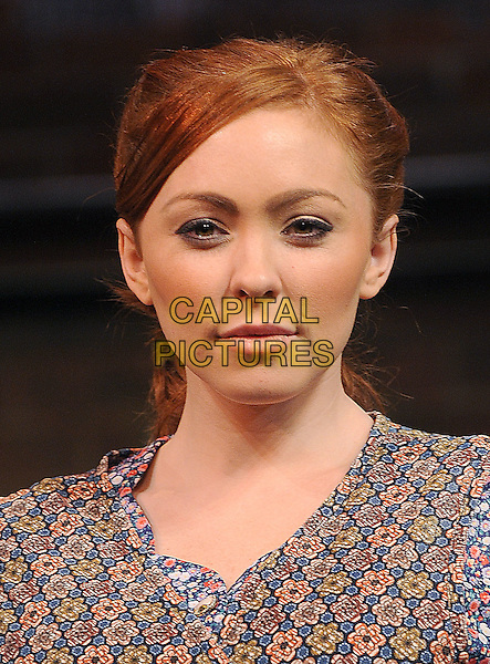 NATASHA HAMILTON.Natasha Hamilton appears as the iconic role of Mrs Johnstone in Blood Brothers, Pheonix Theatre, London, England..24th January 2011.stage acting headshot portrait musical pink brown beige floral print  .CAP/BEL.©Tom Belcher/Capital Pictures.