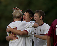 Boston College midfielder Kyle Bekker (10) celebrates his goal with teammates. Boston College defeated Harvard University, 2-0, at Newton Campus Field, October 11, 2011.