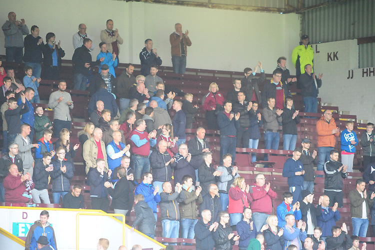 Burnley fans as the players enter the pitch<br /> <br /> Photographer Andrew Vaughan/CameraSport<br /> <br /> Football - Barclays Premiership - Burnley v Stoke City - Saturday 16th May 2015 - Turf Moor - Burnley<br /> <br /> &copy; CameraSport - 43 Linden Ave. Countesthorpe. Leicester. England. LE8 5PG - Tel: +44 (0) 116 277 4147 - admin@camerasport.com - www.camerasport.com