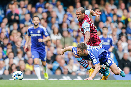 27.09.2014.  London, England. Barclays Premier League. Chelsea versus Aston Villa from Stamford Bridge.  Gabriel Agbonlahor of Aston Villa beats Gary Cahill of Chelsea.  Gary Cahill was booked for pulling Gabriel Agbonlahor back.