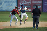 Deep River Muddogs shortstop Alec Bell (10) (Pfeiffer University) holds a tag on Michael Turconi (4) (Wake Forest) of the High Point-Thomasville HiToms as he stands on second base after hitting a double at Finch Field on June 27, 2020 in Thomasville, NC.  The HiToms defeated the Muddogs 11-2. (Brian Westerholt/Four Seam Images)
