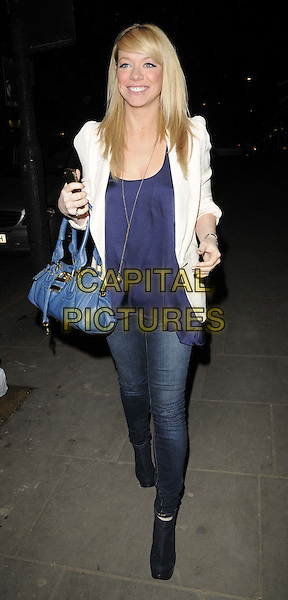 Liz McClarnon.The Chakra new restaurant opening launch party, Chakra bar & restaurant, Notting Hill Gate, London, England..February 9th, 2012.full length black jeans denim blue top white blazer bag purse.CAP/CAN.©Can Nguyen/Capital Pictures.
