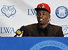 Lawrence Woodmere Academy's Aidan Igiehon, a 6'10 basketball standout from Ireland, speaks after selecting the University of Louisville as his college choice at a news conference at Lawrence Woodmere Academy on Friday, Oct. 19, 2018.