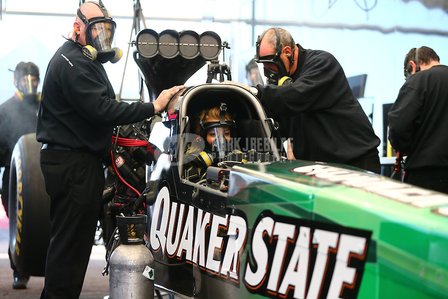Feb 3, 2016; Chandler, AZ, USA; Crew members with NHRA top fuel driver Leah Pritchett during pre season testing at Wild Horse Pass Motorsports Park. Mandatory Credit: Mark J. Rebilas-USA TODAY Sports