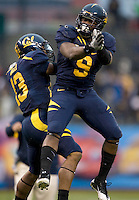 C.J. Anderson of California celebrates with Mike Manuel of California after Anderson scored a touchdown during the game against Washington State at AT&T Park in San Francisco, California on November 5th, 2011.  California defeated Washington State, 30-7.