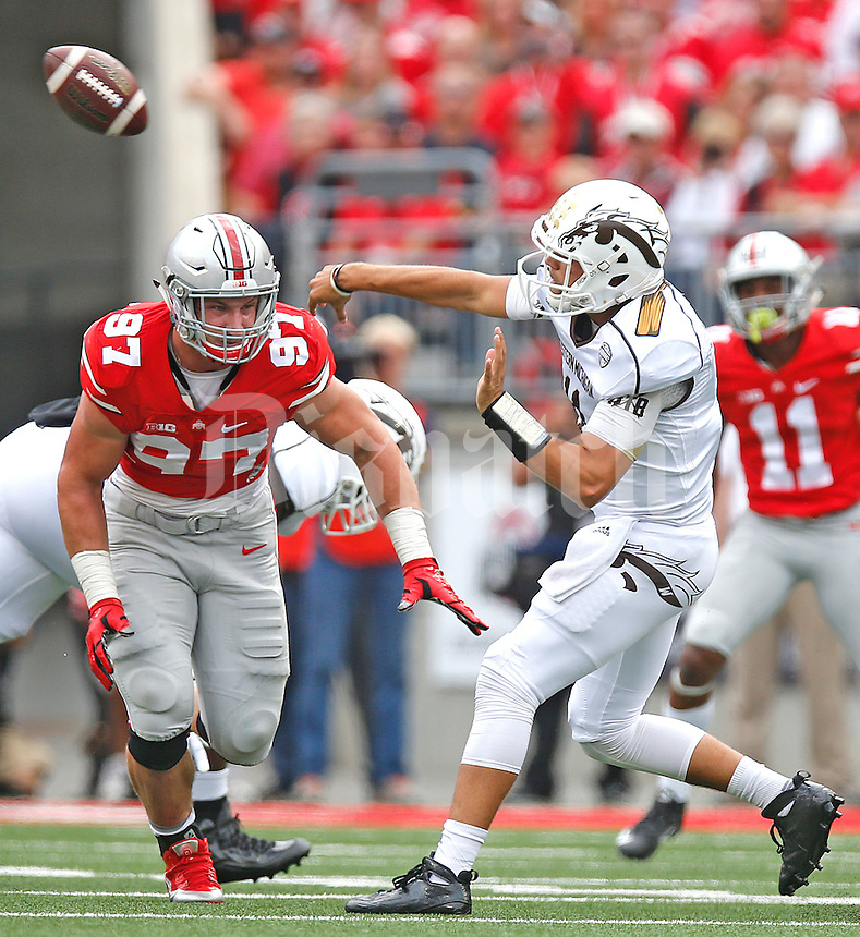 Ohio State Buckeyes defensive lineman Joey Bosa (97) pressures *Western Michigan Broncos quarterback Zach Terrell (11) in first half play at Ohio Stadium on September 26, 2015. (Chris Russell/Dispatch Photo)
