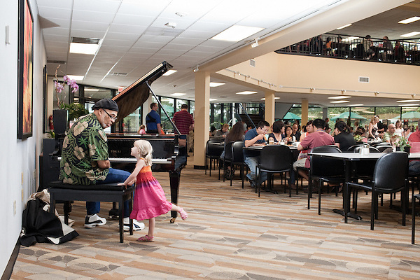 July 29, 2011. Cary, NC.. Elmer Gibson, talking to 4 year old Caitlyn Fulp, plays piano at lunch in one of the SAS campus cafeterias 3 days a week. Meals are relatively cheap and an emphasis is put on healthy food for employees.. Profile of SAS, a software company that has many amenities for its employees.
