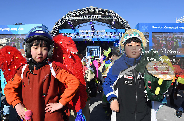 Children perform in front of the live stage. Around the Gangneung Olympic park. Pyeongchang2018 winter Olympics. Gangneung. Republic of Korea. 12/02/2018. ~ MANDATORY CREDIT Garry Bowden/SIPPA - NO UNAUTHORISED USE - +44 7837 394578