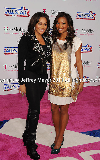 LOS ANGELES, CA - FEBRUARY 20: LaLa Vazquez and Gabrielle Union arrive at the T-Mobile Magenta Carpet at the 2011 NBA All-Star Game at L.A. Live on February 20, 2011 in Los Angeles, California.