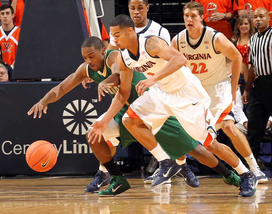 Nov. 12, 2010; Charlottesville, VA, USA;  William & Mary Tribe guard Kendrix Brown (1) fights for a loose ball with Virginia Cavaliers guard Mustapha Farrakhan (2) during the game at the John Paul Jones Arena. Virginia won 76-52.  Mandatory Credit: Andrew Shurtleff-