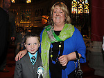 Lorcan Mallon from Congress Avenue school who received first holy communion in St Mary's church pictured with Godmother Louise Purtill. Photo: Colin Bell/pressphotos.ie