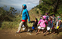 Sri Lanka selection<br /> Bandarawela, Uva Province, Sri Lanka.<br /> Poor families working in tea plantations up in the mountain<br /> School run - man takes a group of children to school in mountains<br /> <br /> Picture by Gavin Rodgers/ Pixel8000<br />  07917221968