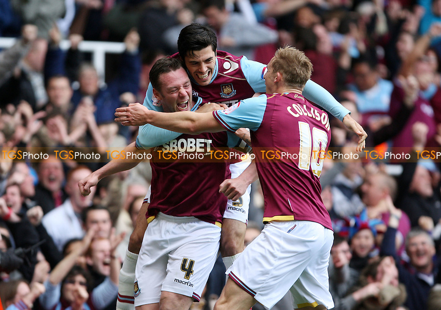 Kevin Nolan celebrates with James Tomkins and Jack Collison after scoring the 1st goal for West Ham - West Ham United vs Cardiff City, npower Championship Play-off Semi-Final 2nd leg at Upton Park, West Ham - 07/05/12 - MANDATORY CREDIT: Rob Newell/TGSPHOTO - Self billing applies where appropriate - 0845 094 6026 - contact@tgsphoto.co.uk - NO UNPAID USE..
