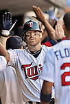 29 September 2012: Minnesota Twins catcher Ryan Doumit gets congratulations in the dugout after hitting an 8th inning Grand Slam against the Detroit Tigers at Target Field in Minneapolis, MN. The Tigers defeated the Twins 6-4 in the second game of their 3-game series. Mandatory Credit: Ed Wolfstein Photo