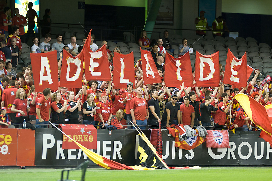 MELBOURNE, AUSTRALIA - OCTOBER 30: United fans cheer on their team at the round 12 A-League match between the Melbourne Victory and Adelaide United at Etihad Stadium on October 30, 2010 in Melbourne, Australia.  (Photo by Sydney Low / Asterisk Images)