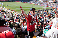 A South Korea fan leads other supporters in cheers for the South Korea team at  Soccer City in Johannesburg, South Africa on Thursday, June 17, 2010 during Argentina's and South Korea FIFA World Cup first round match.